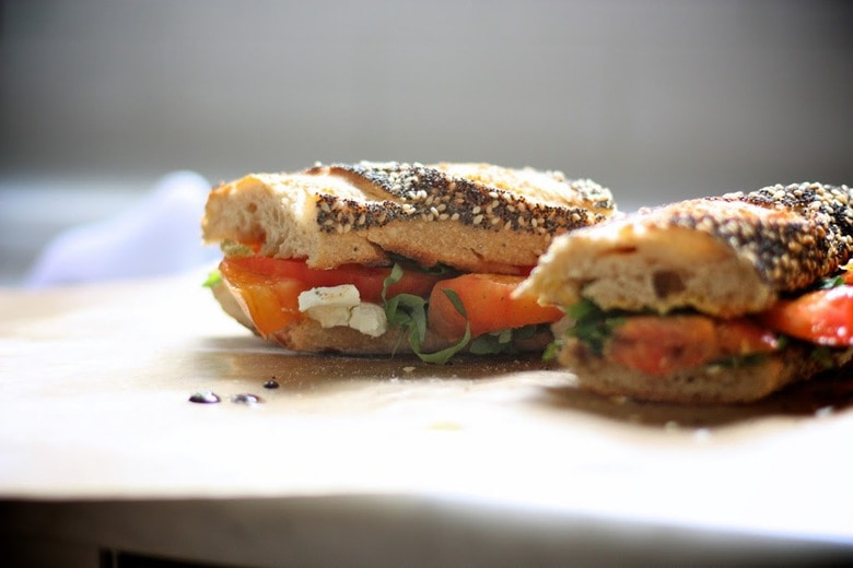 A simple vegan recipe for Heirloom Tomato and Basil Sandwich with arugula ...perfect for picnics or lunch on the go. | www.feastingathome.com