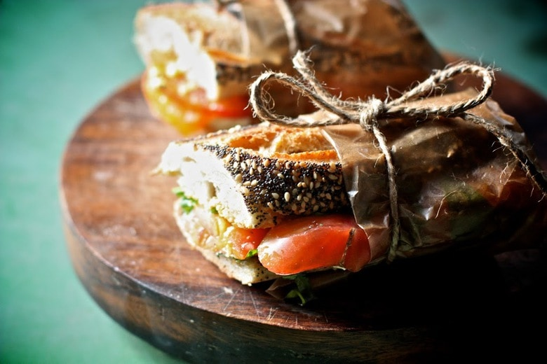 A simple delicious recipe for Heirloom tomato basil sandwich with arugula ...perfect for picnics or lunch on the go.
