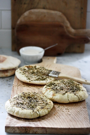 A simple recipe for Zaatar, a middle eastern spice mix. Here is sprinkled on Pita with a little olive oil and baked...for a healthy snack.| www.feastingathome.com