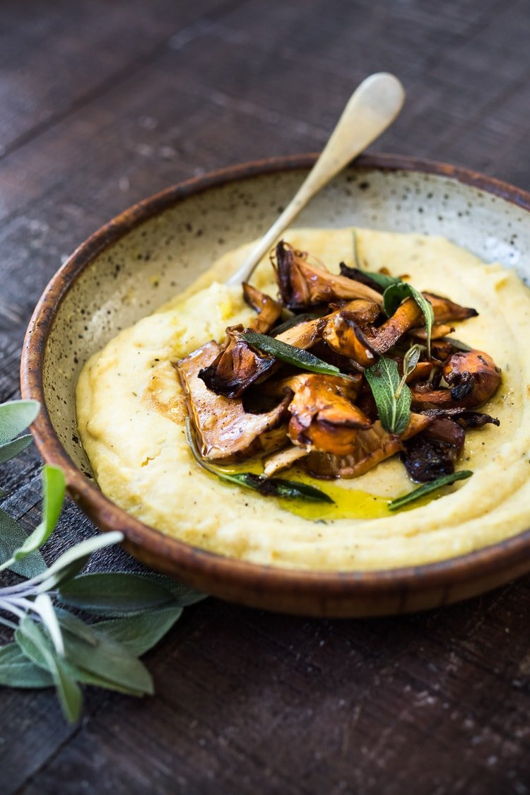 Creamy Polenta with Wild Mushrooms, Garlic and Sage. A simple EASY dinner that can be made in under 30 minutes. Comfort food that is healthy, vegan adaptable and gluten-free! | #polenta #creamypolenta #mushrooms #morels #chanterelles #mushroompolenta #polenta #vegan