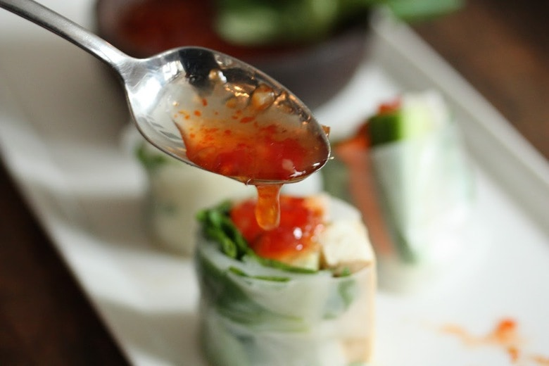 A simple recipe for Vietnamese Spring Rolls with tofu, avocado, radish, carrots, cucumber and fresh mint. | www.feastingathome.com