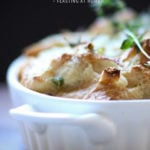 Savory Leek Bread Pudding with Gruyere and Thyme - a delicious side dish, perfect for the holiday table. #leek #leekrecipes #breadpudding #side #sidedish #thanksgiving | www.feastingathome.com