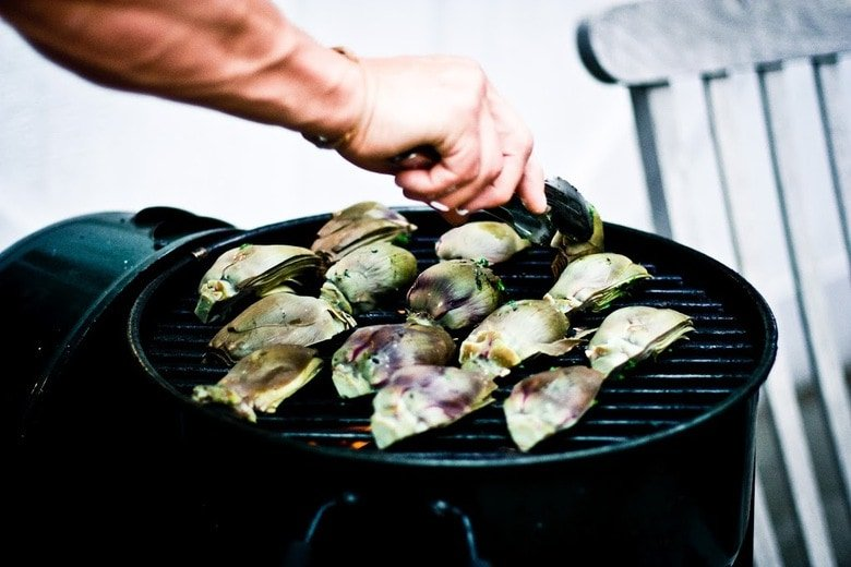 Grilled Artichokes with vegan adaptable Basil Aioli and herb oil - a delicious way to serve artichokes!