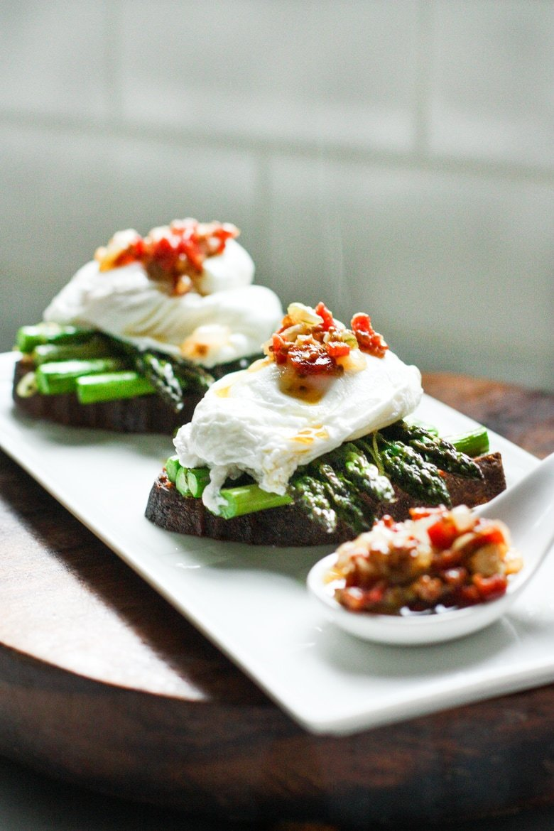 Asparagus Toast with Poached Eggs and a warm Bacon Vinaigrette...a simple, delicious breakfast from a charming cafe in Paris.| www.feastingathome.com #asparagus #toast #eggs