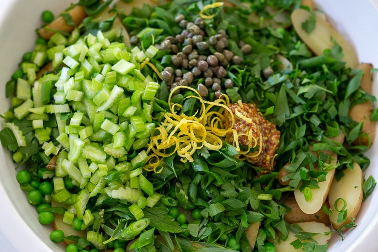 add capers, zest and mustard to the salad