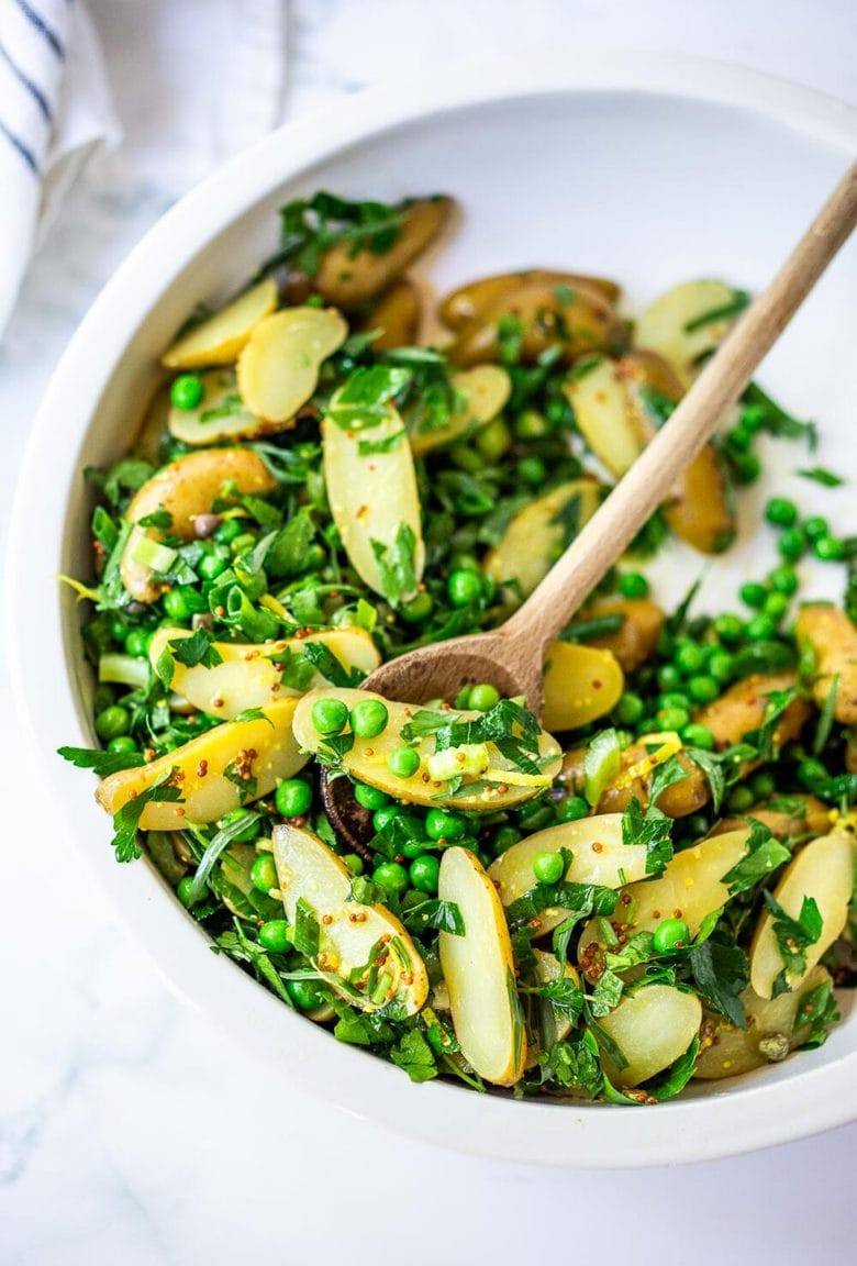 Potato Pea Salad with an herby Tarragon dressing. This zesty, vegan potato salad is loaded with fresh herbs and flavor! A delicious, healthy salad that can be made ahead.#potatosalad