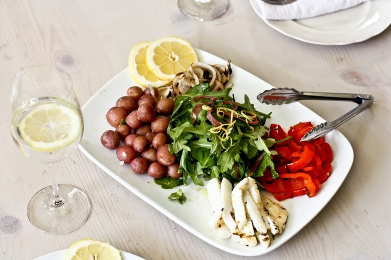 A delicious recipe for Grilled Calamari Salad with Preserved Lemon Vinaigrette with Spanish style chorizo, arugula, roasted peppers & potatoes.