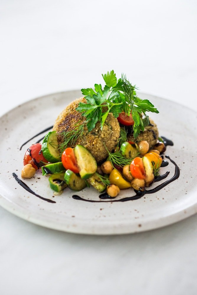 Crispy Vegan Quinoa Cakes with Tomato Chickpea Relish- a delicious, healthy flavorful vegan dinner that is gluten-free.  #quinoacakes #vegan #veganquinoa #veganquinoacakes #veganquinoarecipes #quinoapatties #glutenfree