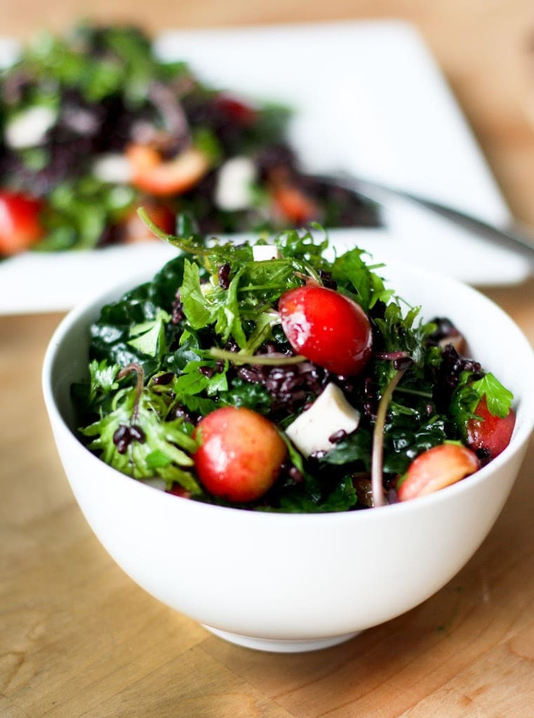 Kale Salad highlighting fresh summer cherries with black rice, halloumi and mint! #farmersmarketrecipes #cherrysalad #cherries #cherryrecipes