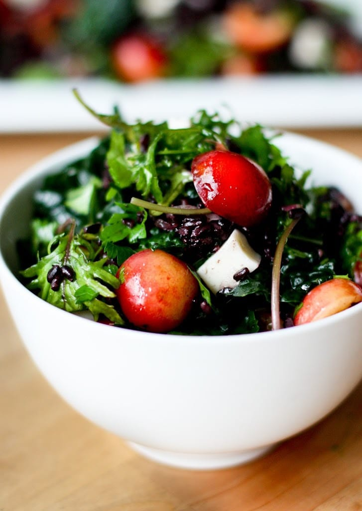 Kale Salad with fresh cherries, black rice, Haloumi and Mint! A simple summer salad that can be made ahead! #cherries #freshcherries #cherrysalad