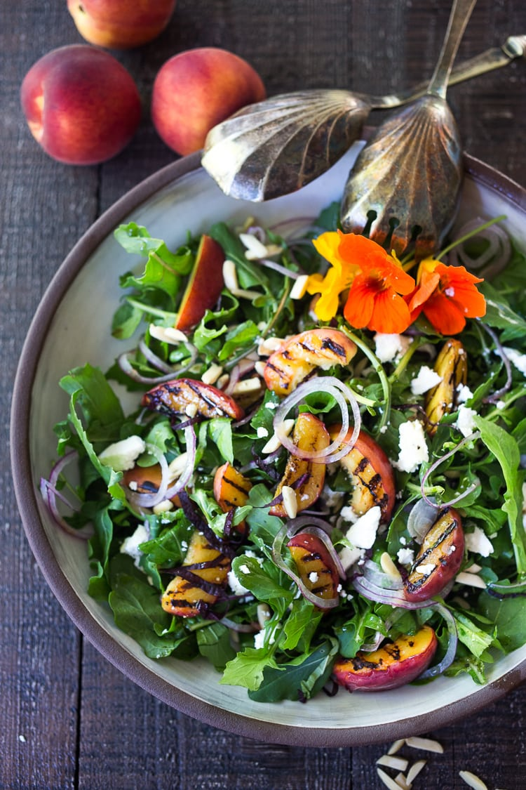 Grilled Peach and Arugula Salad with basil and a White Balsamic Vinaigrette -a simple tasty recipe using fresh seasonal peaches! #peachsalad #peaches #arugula #peacharugulasalad