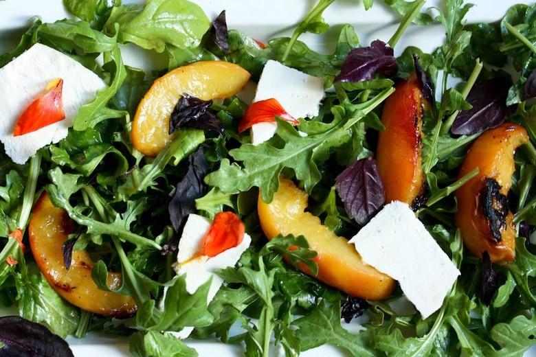 Grilled Peach and Arugula Salad with basil and a White Balsamic Vinaigrette -a simple tasty recipe using fresh seasonal peaches!