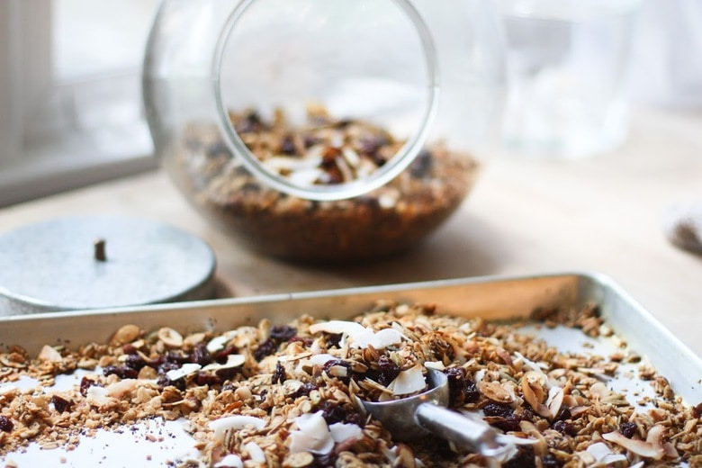 Easy Overnight Granola packed with clusters of nuts & seeds, coconut flakes, sweetened w/ maple. 5 minutes of prep, bakes overnight. Vegan and Gluten free!   www.feastingathome.com