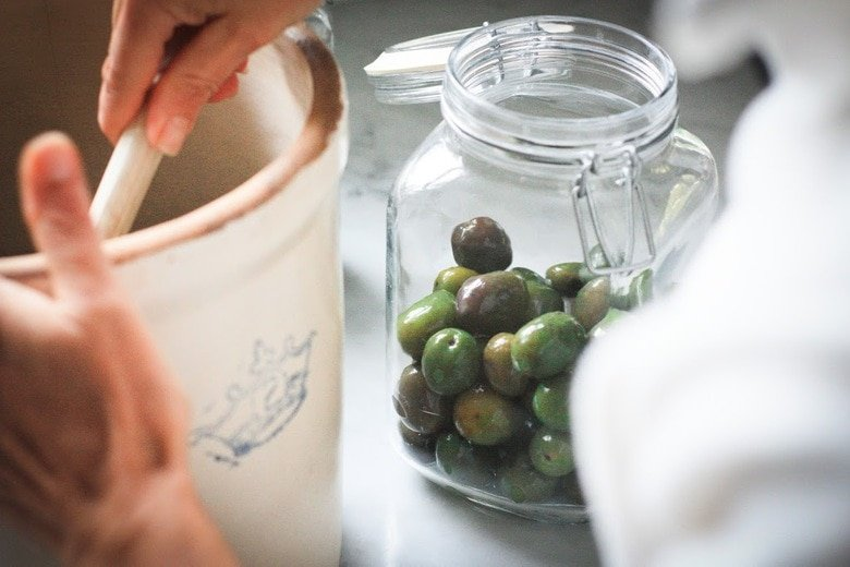 How to Cure Olives with Lye - a step by step guide, that turns bitter olives into buttery delicious bites the whole family will enjoy. #curedolives #howtocureolives #lyecuredolives