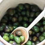 How to Cure Olives with Lye - a step by step guide, that turns bitter olives into buttery delicious bites the whole family will enjoy. #curingolives #curedolives #howtocureolives