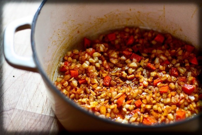 A deliciously flavorful recipe for Berbere Chicken over Ethiopian spiced Lentils with an easy recipe for Berbere Spice Blend. | www.feastingathome.com
