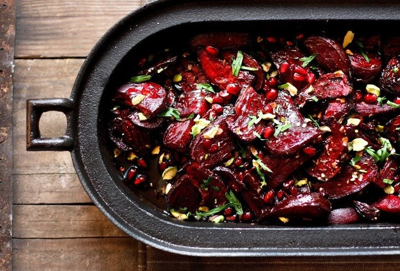 Moroccan Roasted Beets with Pomegranate Seeds, toasted pistachios and a balsamic glaze. A simple, healthy vegan side dish. #moroccanbeets #veganside #roastedbeets #cleaneating #plantbased