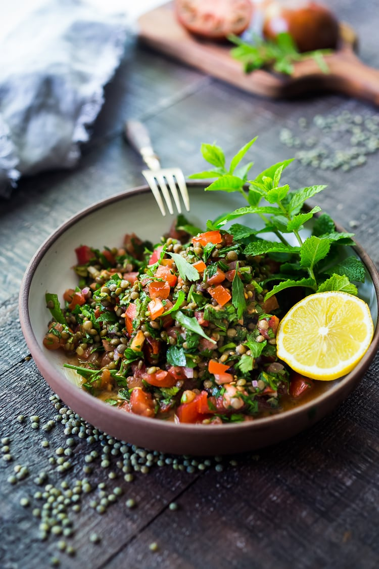 25 Best Lentil Recipes! | This Simple Lentil Tabouli Salad is full of Middle Eastern flavor! Filling lentils are paired with summer  tomatoes, lemon, mint and parsley and a unique combination of spices, and keeps for several days, perfect for midweek lunches or potlucks! Vegan and Gluten-Free #tabouli #lentil #lentils #lentilsalad #lentiltabouli #lentiltabbouleh #tabbouleh #vegan #salad #glutenfree
