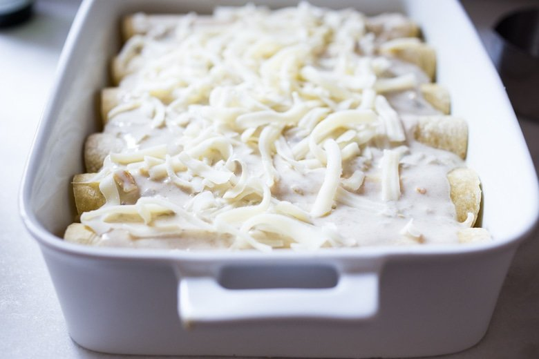 White Chicken Enchiladas with Creamy Poblano Sauce- an easy, delicious comfort food meal. These creamy chicken enchiladas will not disappoint! #whitechickenenchiladas #chickenenchiladas #creamychickenenchiladas #enchiladas #comfortfood