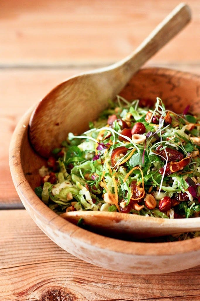 Brussel Sprout Slaw with Hazelnuts and dates+ 20 delicious Vegetarian SIDE DISHES that will turn your dinner into a feast! | www.feastingathome.com