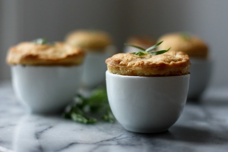 A Spring Vegetable Pot Pie - bridges the gap between seasons by utilizing the new vegetables of Spring, in a warm and comforting way. VEGAN, Easy and adaptable | www.feastingathome.com