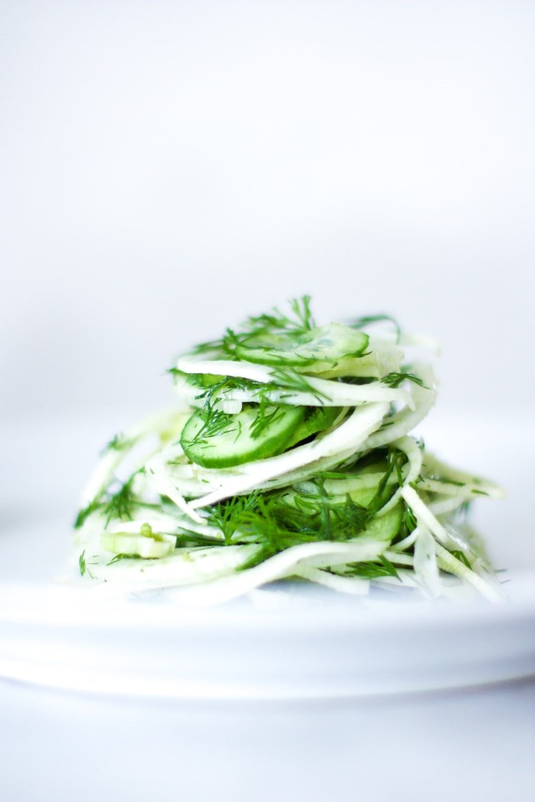 Simple, delicious Fennel Salad with cucumber and fresh Dill. Refreshing and light, this vegan salad can be made ahead, and pairs with so many things! #fennelsalad #fennel #vegansalad #plantbased #fennelslaw
