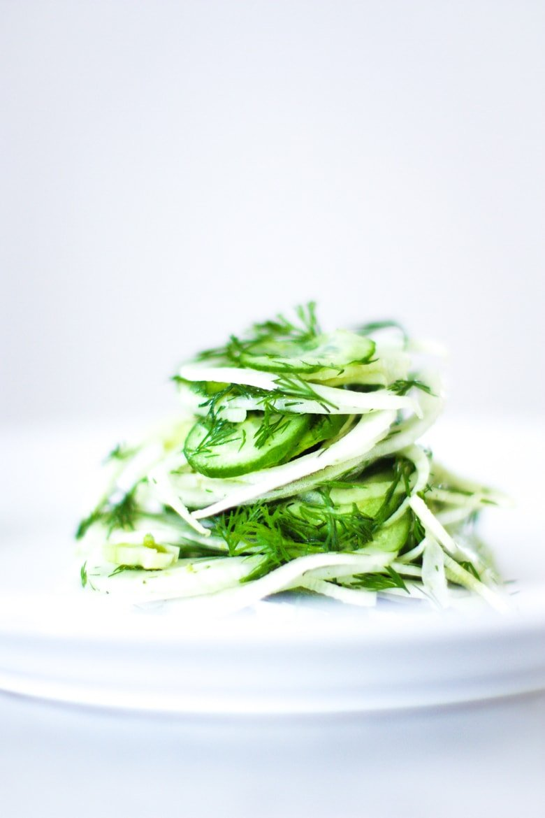 Simple, delicious Shaved Fennel Salad with dill, cucumber and Meyer Lemon. Refreshing and light, this pairs very well with simple roasted salmon. | www.feastingathome.com # fennel #fennelslaw