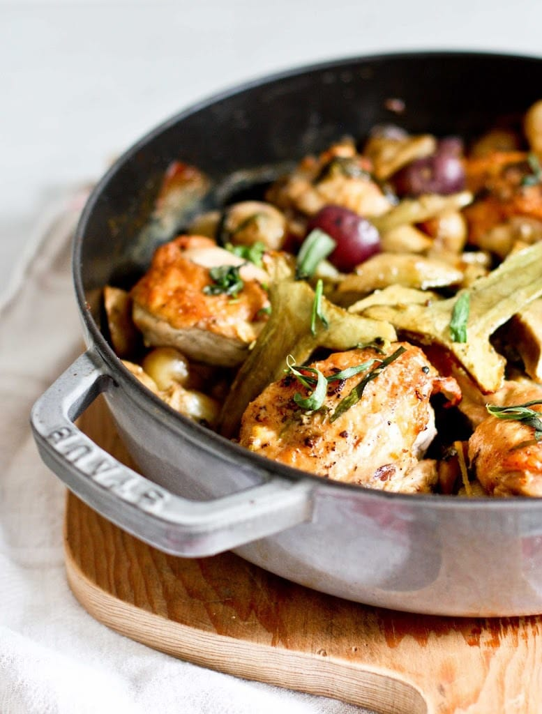 Braised Crispy Chicken Thighs with Artichoke hearts, leeks, potatoes and tarragon- a delicious one-pan recipe perfect for spring!