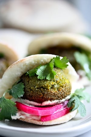 40 Mouthwatering Vegan Dinner Recipes!| Falafels with Tahini Sauce. This authentic recipe is made with soaked, uncooked chickpeas and hands-down has the BEST texture and flavor! So easy! Bake them or pan-sear them. Great in wraps, bowls, or salads. |  #falafel #falafels #falafelrecipe #falafelsalad, #bowl #veganfalafelrecipe #bakedfalafel #vegan #easyfalafel
