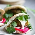 Falafels with Tahini Sauce. This authentic recipe is made with soaked, uncooked chickpeas andhands-down has the BEST texture and flavor! So easy! Bake them or pan-sear them. Great in wraps, bowls, or salads. | #falafel #falafels #falafelrecipe #falafelsalad, #bowl #veganfalafelrecipe #bakedfalafel #vegan #easyfalafel