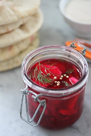 Don't know what to do with Turnips?? Pickled them!! So delicious in Falafels! Dyed with a sliver of beet. | www.feastingathome.com