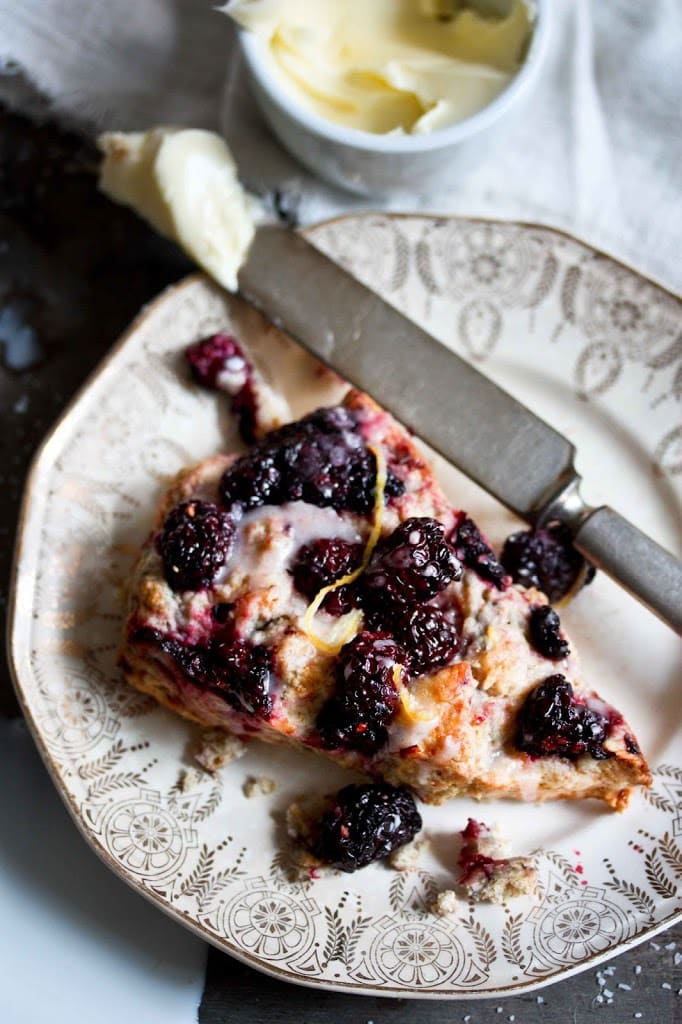 Blackberry Sourdough Scones with Lemony Glaze- plus a little baking tip to help keep blackberries in tact! | www.feastingathome.com