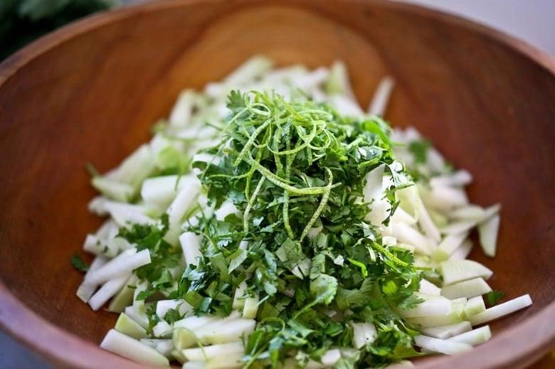 Delicious and refreshing Kohlrabi Slaw with cilantro, jalapeño and lime! Vegan, GF   www.feastingathome.com #kohlrabi #kohlrabirecipes #kohlrabislaw #kohlrabirecipe #kohlrabisalad