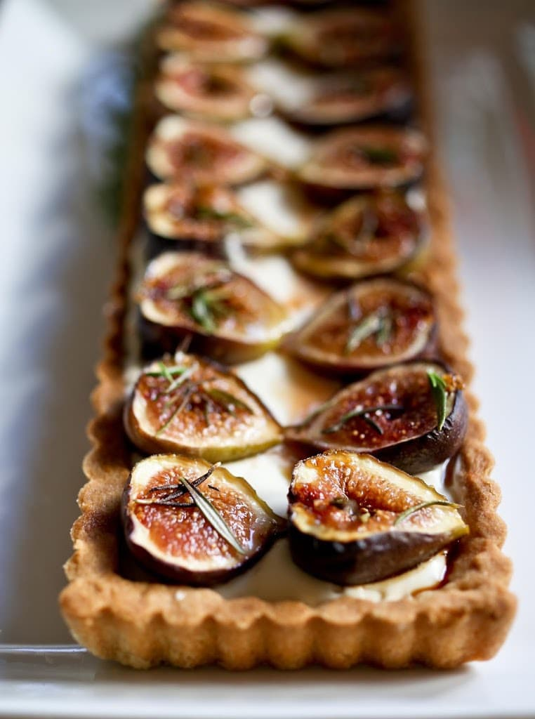 Delicious recipe for Roasted Fig Tart with Goat cheese, Mascarpone Honey and rosemary....using fresh figs, lightly roasted and caramelized in the oven. | www.feastingathome.com