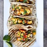 Chipotle Fish Tacos with Peach Salsa | www.feastingathome.com