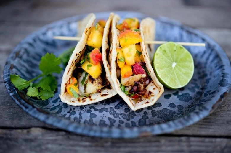 Grilled Chipotle Fish Tacos with a refreshing Peach Salsa. Summery and light with a little bit of heat. #fishtacos #peaches #peachsalsa #peach #chipotle #grilling
