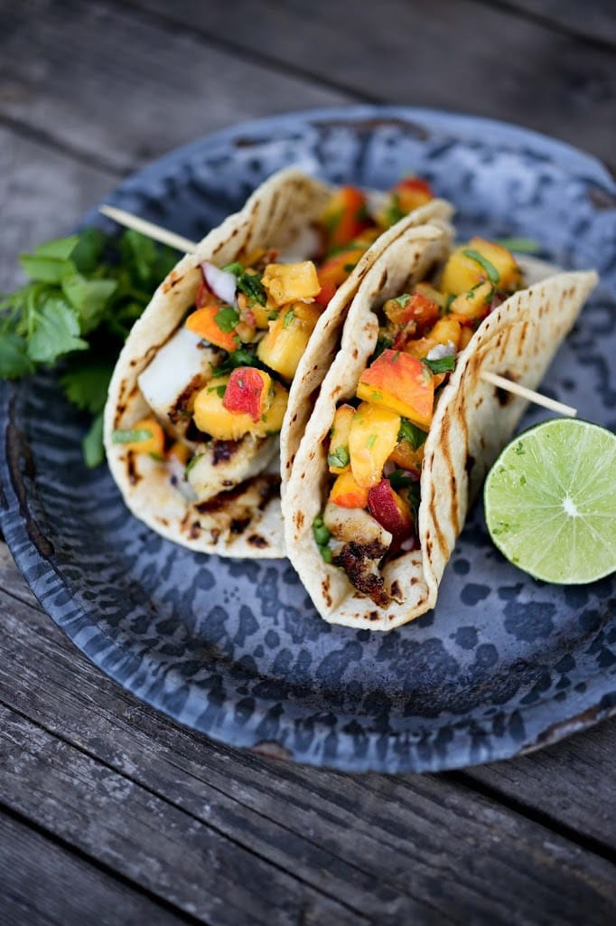 Grilled Chipotle Fish Tacos with fresh Peach Habanero Salsa. Delicious summertime flavor!   www.feastingathome.com
