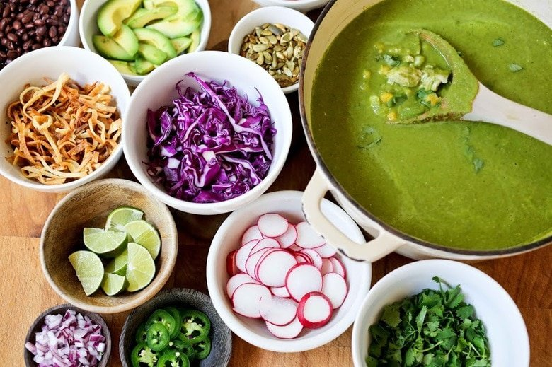 toppings for pozole verde in various bowls