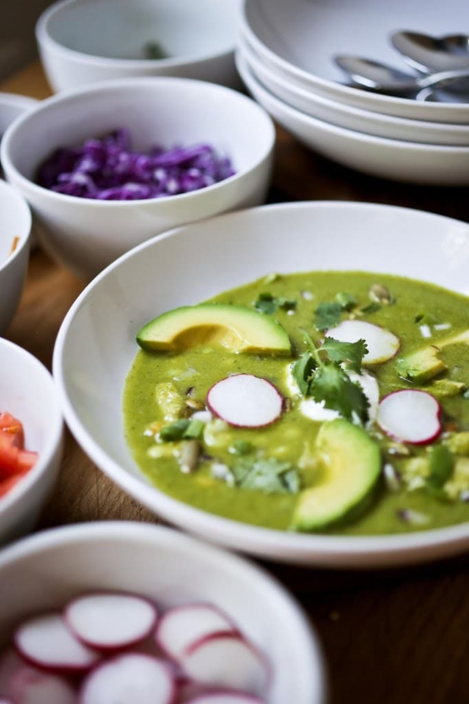 Pozole Verde Recipe! ( aka Green Pozole) This version the classic Mexican soup is lightened up with chicken (instead of pork) and is full ofamazing flavor! Loaded up with veggies, this makes for healthy, delicious dinner, with lots of texture and flavor. Perfect for entertaining!#posole #pozole #verde #mexicansoup #soup #stew #glutenfree #paleo #greenpozole