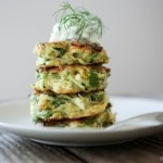 How to make Zucchini Fritters! An easy recipe with dill, feta and tzatziki sauce. A Greek spin on our favorite fritters ! #Zucchinifritters #zucchinirecipes #zucchinicakes