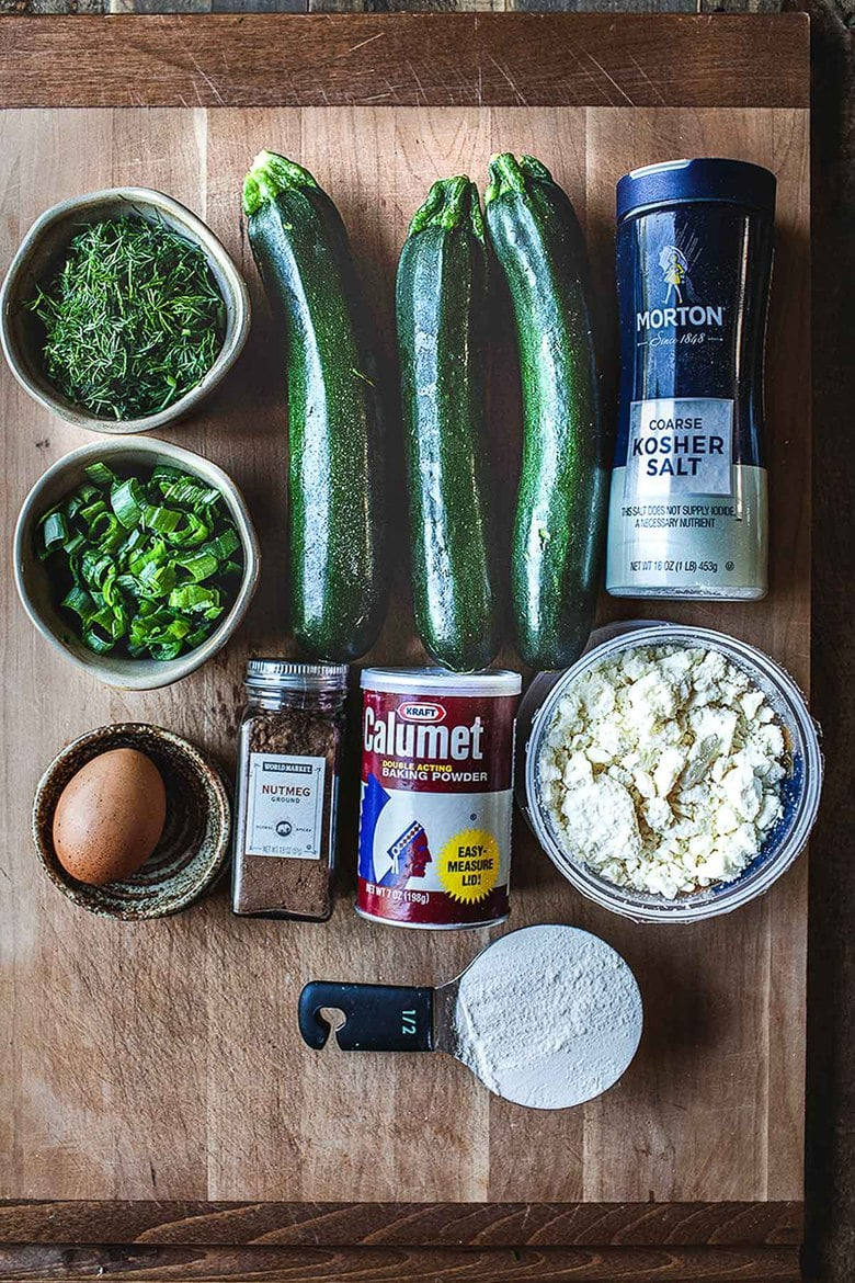 Ingredients in Zucchini Fritters with dill, feta and Tzatziki Sauce, a simple easy way to use up summer squash and zucchini! Healthy and light! #zucchinifritters #zucchinicakes #zucchinirecipes
