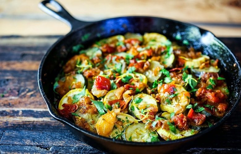 Rustic Zucchini Tian- A baked zucchini dish with Middle Eastern flavors thats vegan and GF. Serve over Rice for a simple delicious meal. | www.feastingathome.com