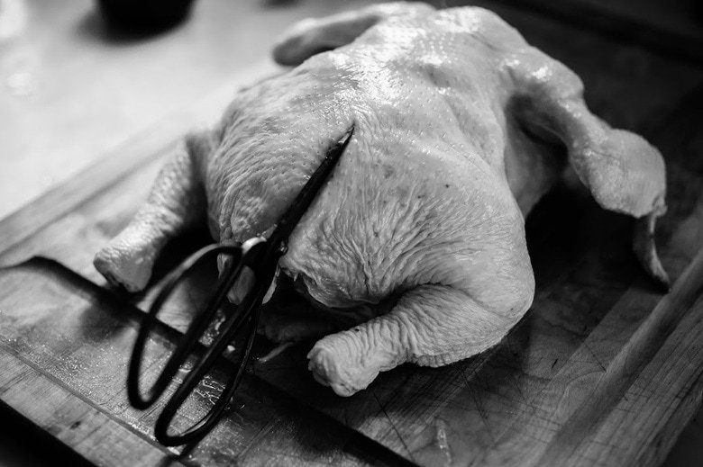 cutting the backbone out of the chicken