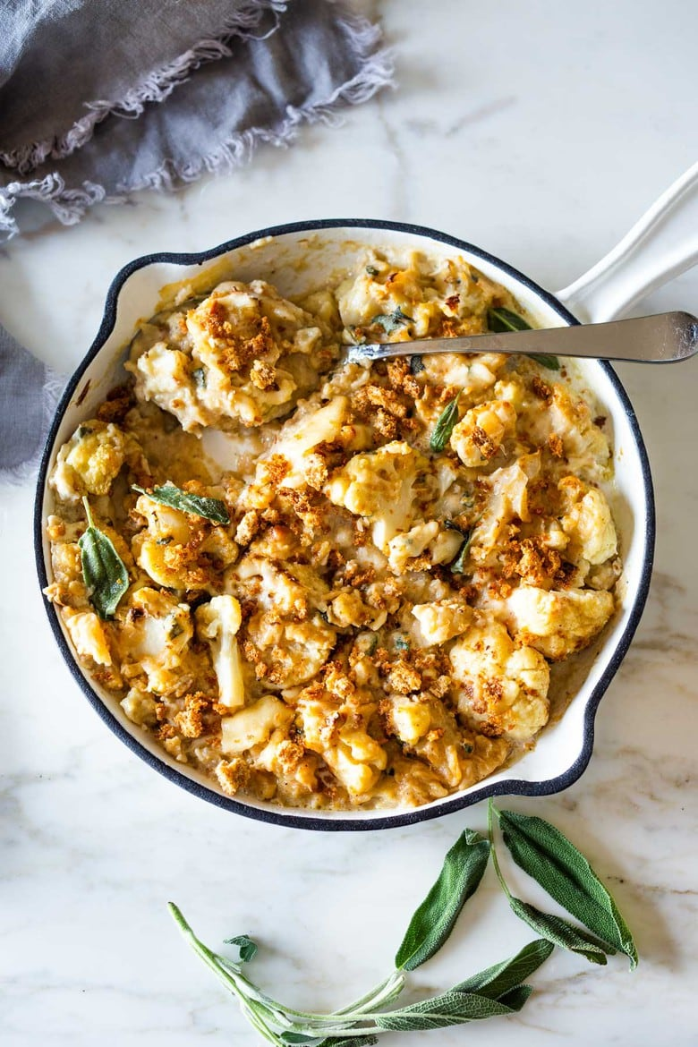 Roasted Cauliflower Gratin with garlic and sage, a delicious vegetarian side dish that is keto, low carb and gluten-free- adaptable, perfect for the holiday table! #cauliflower #cauliflowergratin #lowcarbside #sidedish #lowcarb #keto #thanksgivingside #christmassidedish