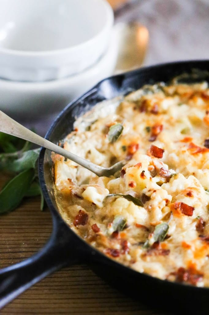 Cauliflower Gratin with garlic and sage, a delicious vegetarian side dish that is keto, low carb and gluten-free, perfect for the holiday table! #cauliflower #cauliflowergratin #lowcarbside #sidedish #lowcarb #keto #thanksgivingside #christmassidedish