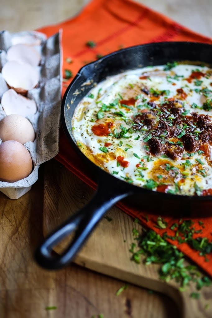 Creamy Polenta with poached eggs, chorizo and cilantro- a flavorful hearty brunch! #polenta #eggs #chorizo #brunch #breakfast #brunchrecipes #polentaeggs