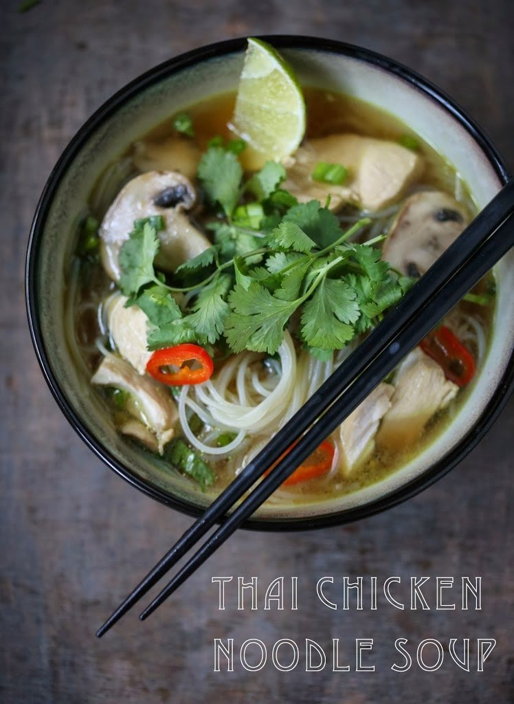 A steaming bowl of Thai Chicken Noodle Soup infused with lemongrass and ginger.  A healthy, low fat, gluten-free meal, full of amazing Thai flavors! #thaisoup #chickensoup #thainoodlesoup #lemongrass #broth #brothysoup