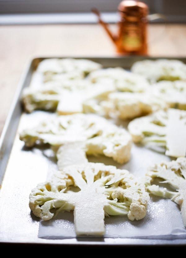 Roasted Cauliflower Steaks with Lemon Herb Gremolada, a healthy delicious side dish you will love!   www.feastingathome.com