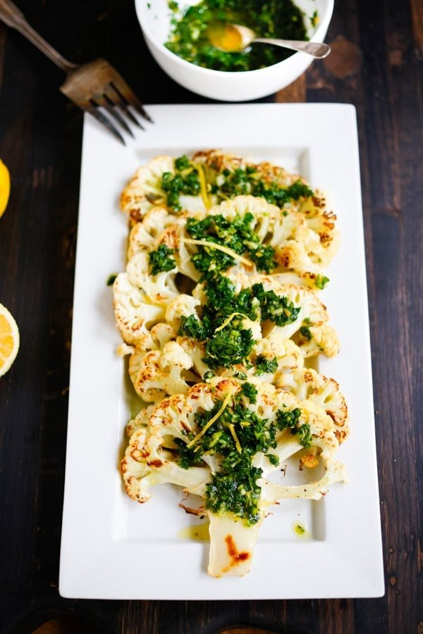 Roasted Cauliflower Steaks with Gremolata + 20 delicious Thanksgiving SIDE DISHES that will turn your dinner into a feast! | www.feastingathome.com