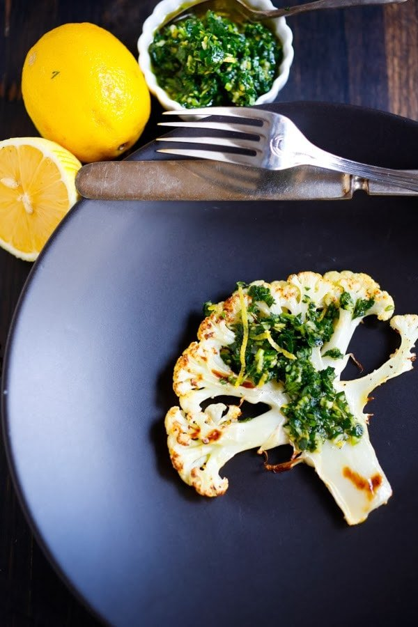 Roasted Cauliflower Steaks with Lemon Herb Gremolada, a healthy delicious side dish you will love! | www.feastingathome.com